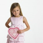 Little Girl in Pink Dress Holding Decorative Valentine's Day Heart